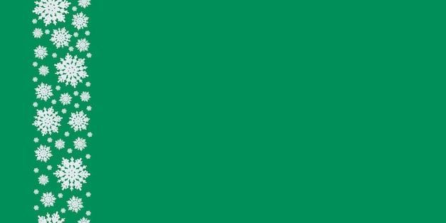 Zielone tło boże narodzenie z jednolitym wzorem płatków śniegu