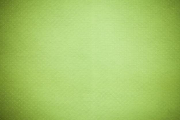 Zielone tło recyklingu papieru.