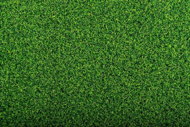 Zielone tło sztucznej trawy