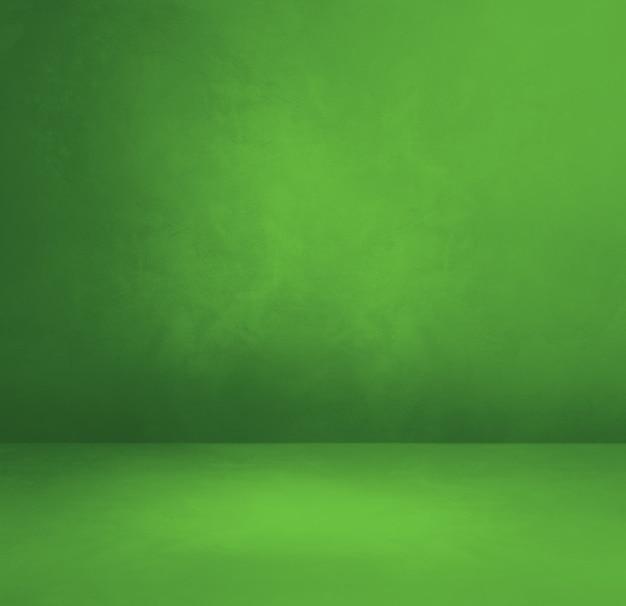 Zielone tło wewnętrzne betonowe.