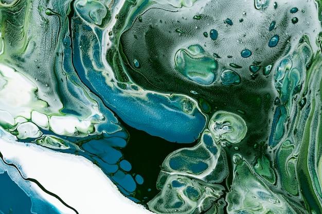 Zielone tło wirowe z marmuru diy płynąca tekstura sztuka eksperymentalna