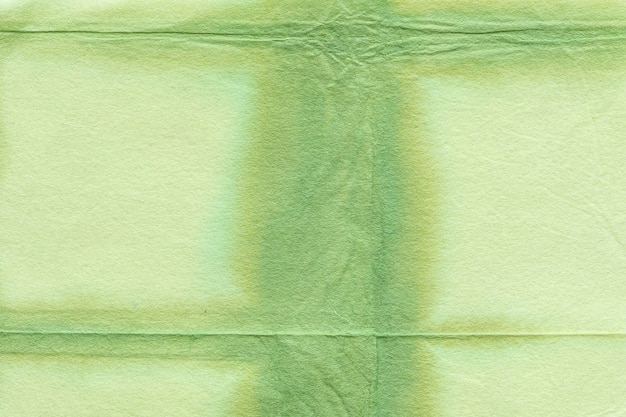 Zielone tło z teksturą shibori