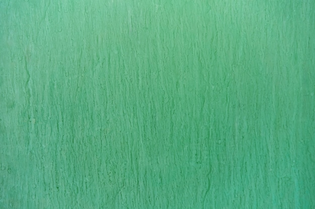 Zielone tło z wyciekami i plamami atramentu.