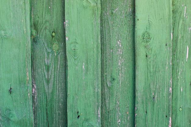 Zielonego rocznika stary drewniany tło