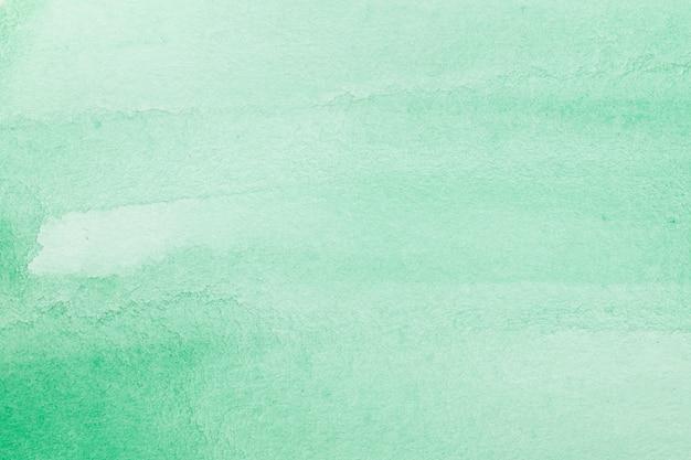 Zielonej abstrakcjonistycznej akwareli tekstury makro- tło