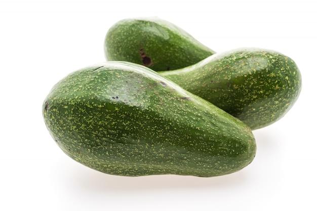 Zielony brązowy tle owoców awokado