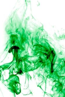 Zielony dym na białym tle