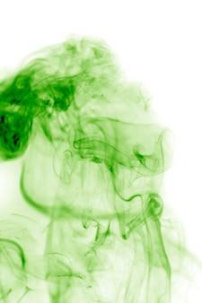 Zielony dym z białym tłem