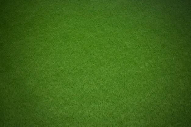 Zielony filc, tekstura tło z winiety