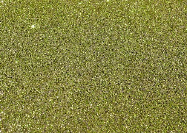 Zielony glittery tekstury tła abstrakt