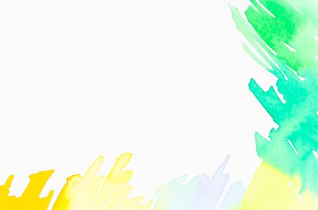 Zielony i żółty projekt akwarela na białym tle