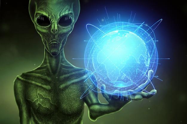 Zielony kosmita, humanoid, trzyma w dłoni hologram kuli ziemskiej. koncepcja ufo, obcy, kontakt z cywilizacją pozaziemską.