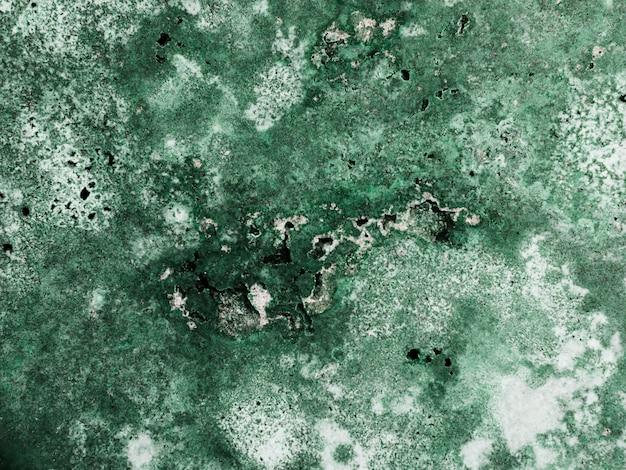 Zielony marmur teksturowanej powierzchni tła