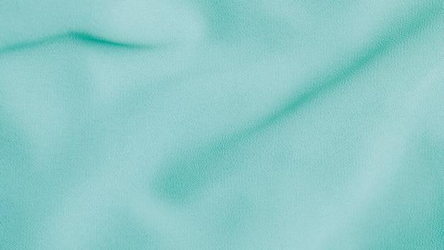 Zielony nowy szyfonowy tkaniny tekstury tło
