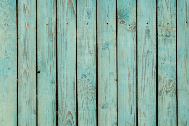 Zielony pastelowy barwiony drewniany tło