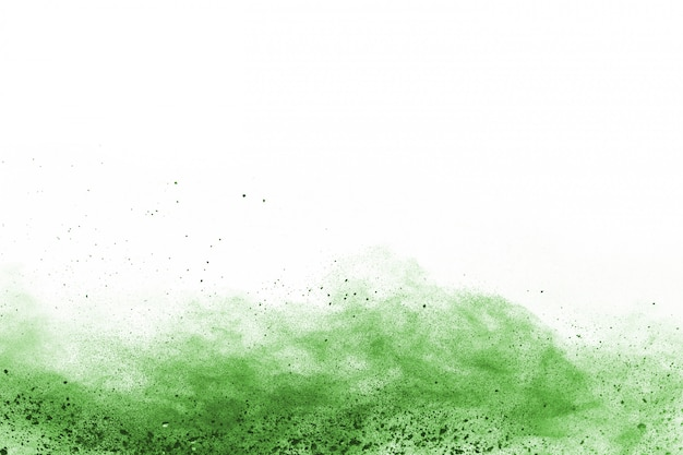 Zielony proszek wybuch na białym tle.