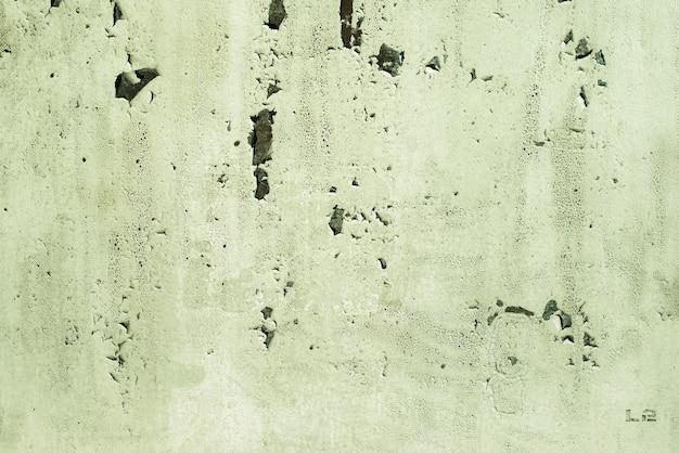 Zielony, seledynowy, tekstura. stare zardzewiałe tła ścienne. szorstkość i pęknięcia.