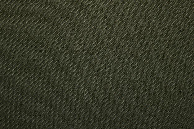 Zielony skośny splot tkaniny wzór tekstury tła zbliżenie