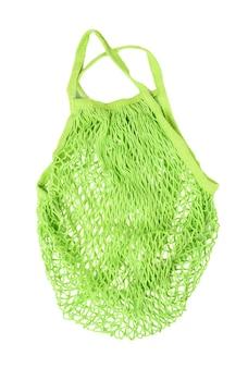 Zielony worek strunowy wielokrotnego użytku tkany z nici na białym tle, zero odpadów