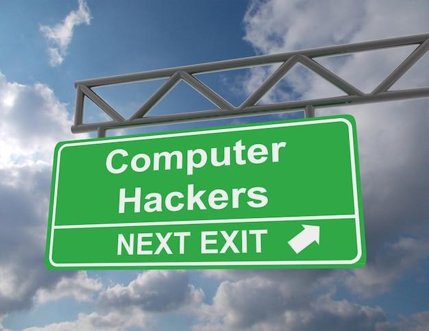 Zielony znak drogowy nad głową z hakerami komputerowymi