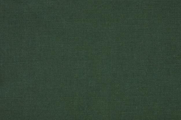 Zielonych cajgów tekstury makro- tło