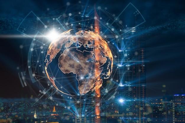 Ziemia cząsteczkowa z kręgiem sieci technologicznej nad zdjęciem zamazanym w tle pejzażu miejskiego