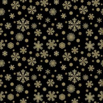 Zimowy czarny ręcznie rysowane bezszwowe wzór nadruku ze złotymi płatkami śniegu