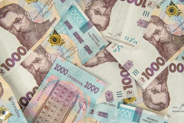 Zł. tło nowego banknotu 1000 ukrainy. koncepcja tego samego i pieniędzy. ukraińskie pieniądze.