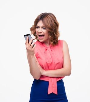Zła kobieta za pomocą smartfona