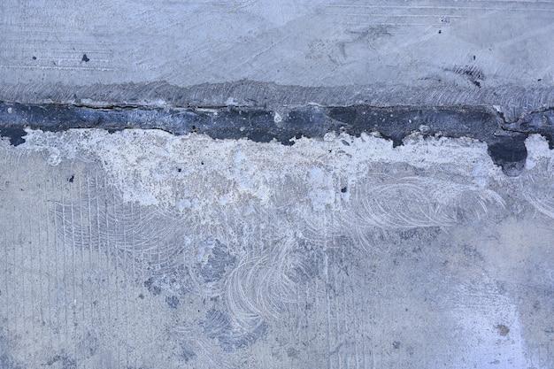 Złącze brudna budowa i szorstki betonowy tło.