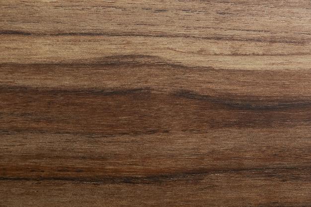 Złocista drewniana tekstury tła powierzchnia z warstwa wzorem