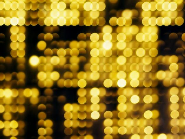 Złocisty abstrakt blured tło i koloru żółtego bokeh