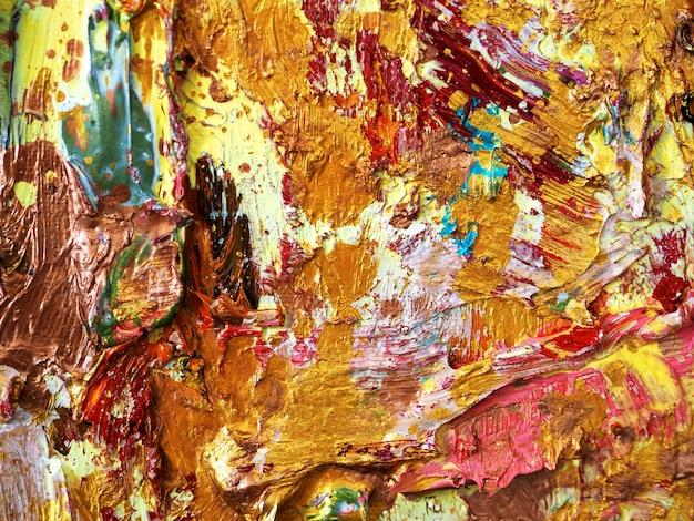 Złocisty kolorowy kolor tekstury abstrakta tło.