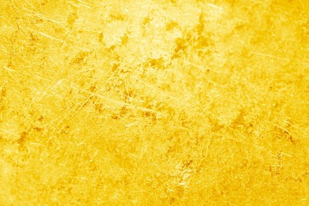 Złocisty tekstury tło.