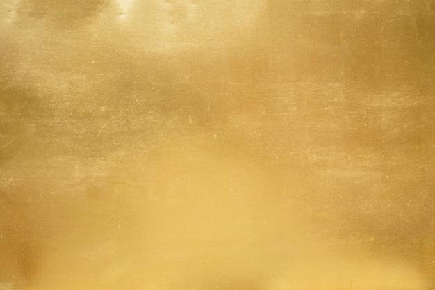 Złocisty tło, tekstura lub gradient cień.