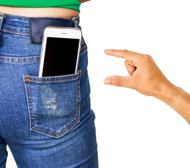 Złodziej ręka próbuje ukradł telefon komórkowy