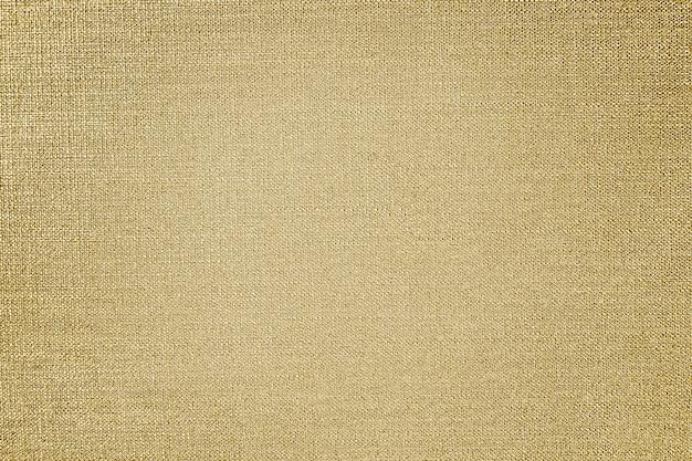 Złota bawełniana tkanina teksturowana w tle