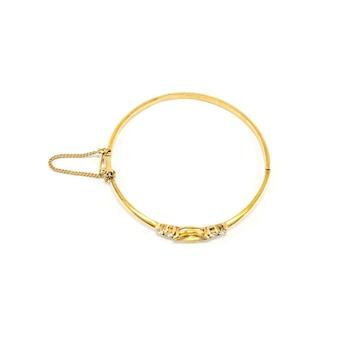 Złota bransoletka na białym tle