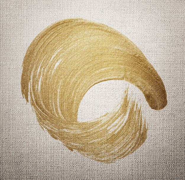 Złota farba olejna obrysu pędzla tekstury na brązowym tle teksturowanej tkaniny