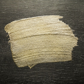 Złota farba olejna obrysu pędzla tekstury na kolorowym drewnie