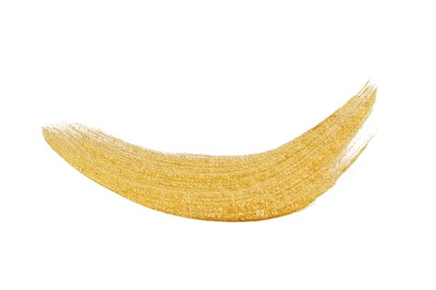 Złota farba, pociągnięcie pędzlem makijaż metaliczny na białym tle