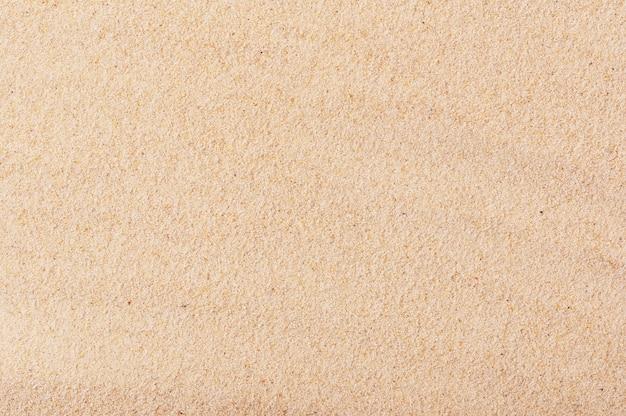 Złota piaszczysta plaża nadmorskiego tła. tekstura piasku.