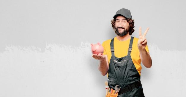 Złota rączka pracownik z prosiątko bankiem