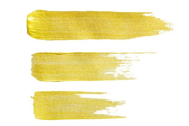 Złota tekstura. ręcznie rysowane pociągnięcia pędzlem.