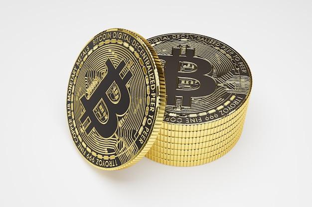 Złote bitcoiny na białym stole