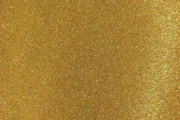 Złote błyszczące tło z błyszczy.