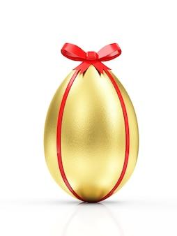 Złote jajko z czerwoną wstążką i łuk na białym tle