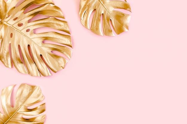 Złote liście na różowym tle