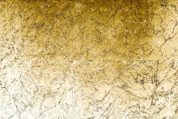 Złote metaliczne teksturowane tło