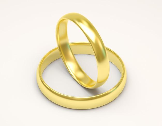 Złote obrączki ślubne na białym tle